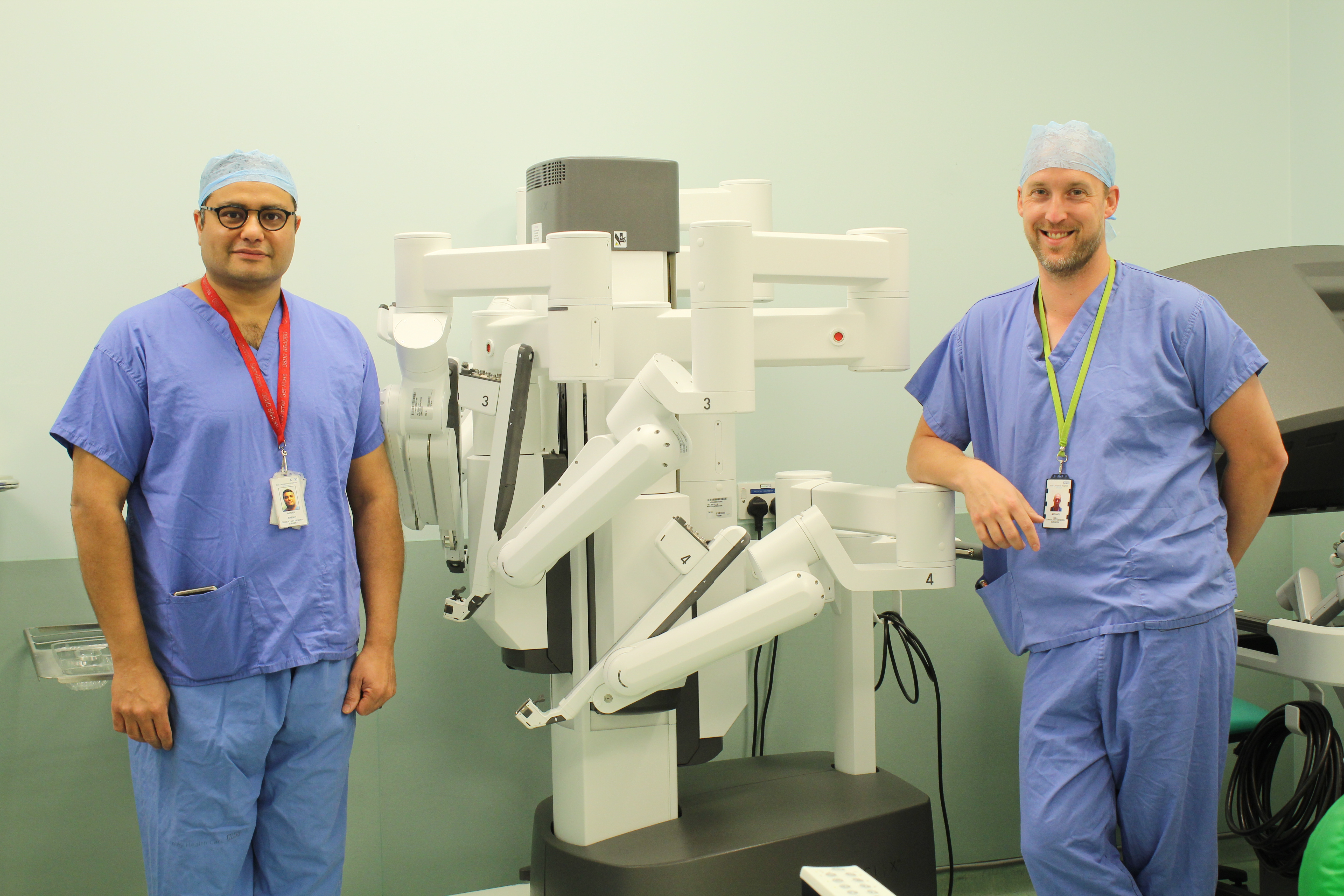 Mr Adnan Sheikh and Mr Micheal Gill with the surgical robot